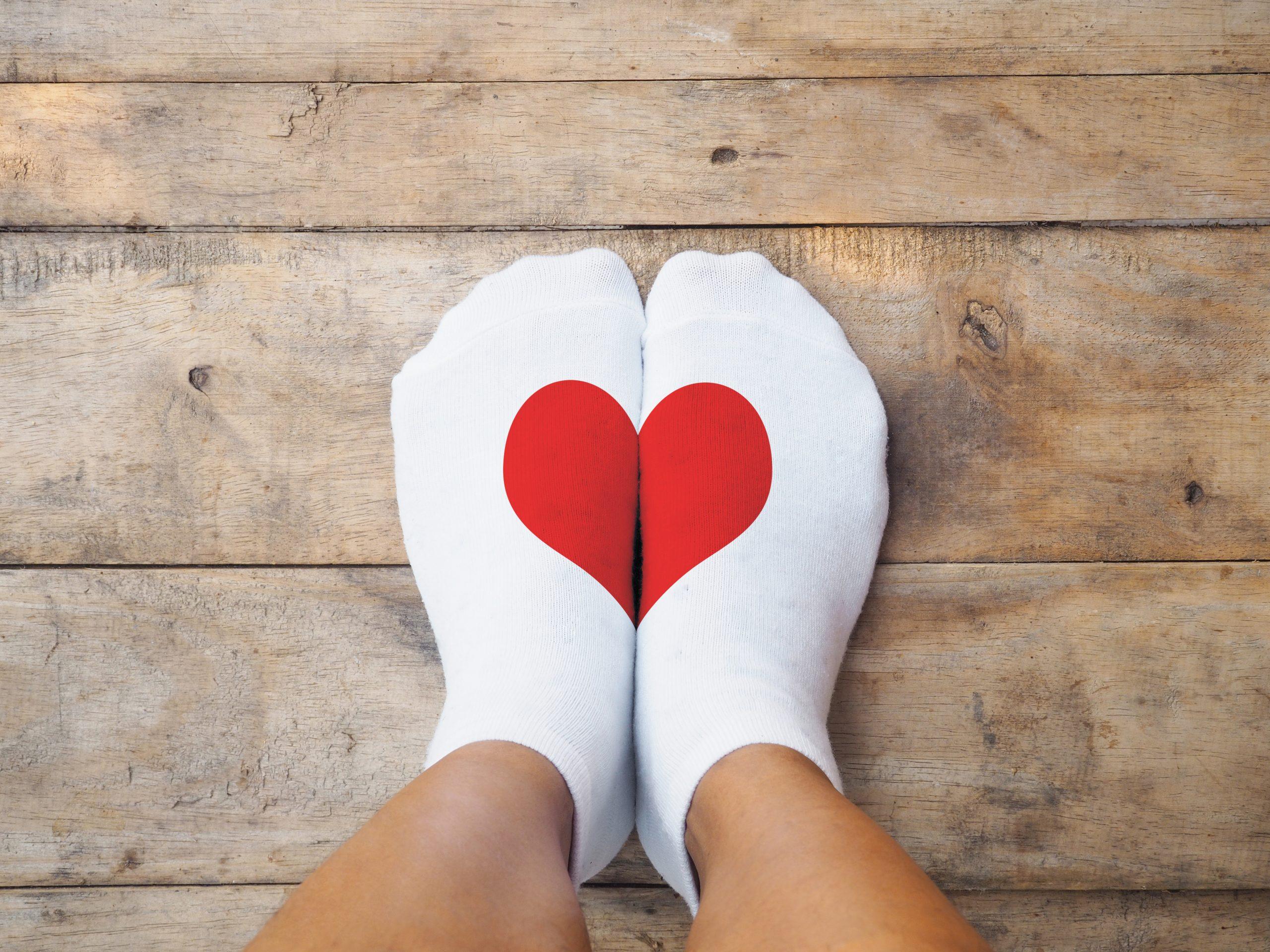 Feet wearing heart socks